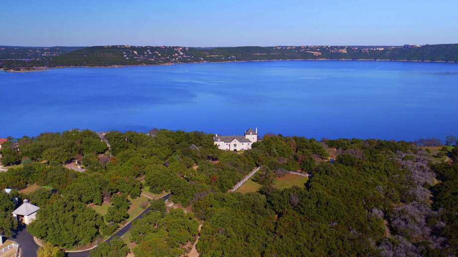 Commander's Point Estate, a 9,600-square-foot stone home styled like an English manor that sits on a cliff overlooking Lake Travis in Austin, is on the market for $22.9 million. Photo: Taylor Davis/Cloud9Drones