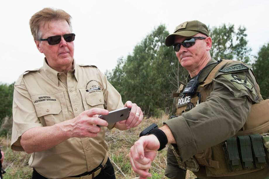 Lt. Gov. Dan Patrick, left, takes a photo of a wristband GPS that shows the location of Texas Ranger Major J.D. Robertson, right, and the location of the border surveillance cameras near him. Without real metrics, the state's efforts have all the makings of boondoggle and heaping helpings from the public pork barrel for DPS. Photo: Marie D. De Jesus /Houston Chronicle / © 2016 Houston Chronicle