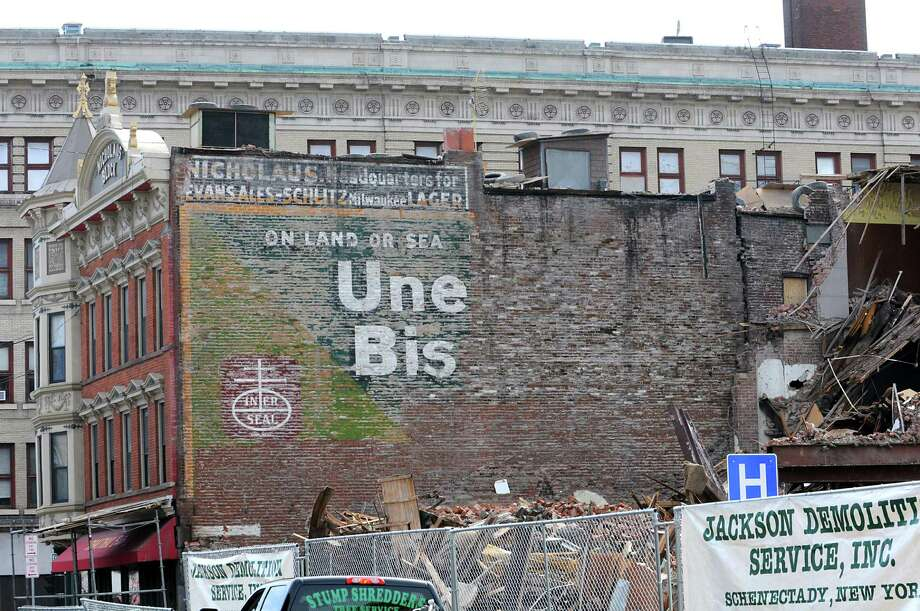 Click through the slideshow and see if you recognize some of these local ghost signs. A ghost sign for beer and Uneeda Bisquits was revealed on lower State Street during prep work for the Electric City Apartments on Wednesday, March 16, 2016 in Schenectady, N.Y. Workers demolished the former Olender Building to make way for the four-story, 105-unit complex called the Electric City Apartments. The building once housed the Olender Mattress company, which closed in 2011.  (Lori Van Buren / Times Union) Photo: Lori Van Buren / 10035862A