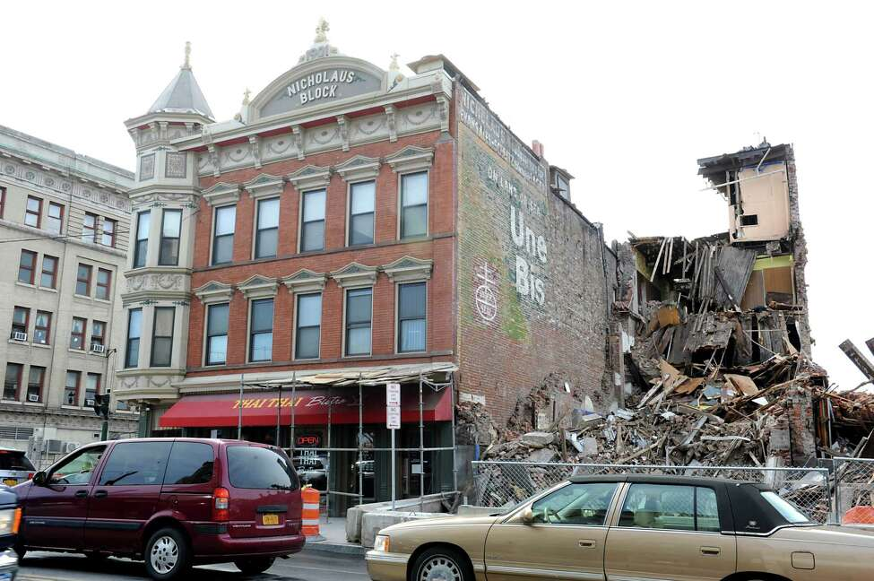 A ghost sign for beer and Uneeda Bisquits was revealed on lower State Street during prep work for the Electric City Apartments on Wednesday, March 16, 2016 in Schenectady, N.Y. Workers demolished the former Olender Building to make way for the four-story, 105-unit complex called the Electric City Apartments. The building once housed the Olender Mattress company, which closed in 2011. (Lori Van Buren / Times Union)