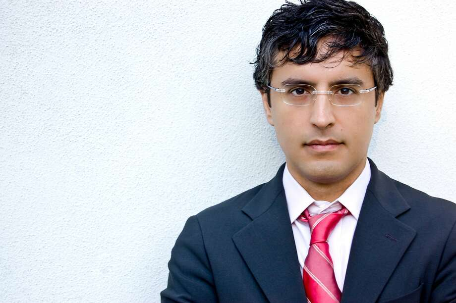 "Religious scholar Reza Aslan is the host of CNN's new show ""Believer,"" a six episode series exploring ""the world's most fascinating faith-based groups."" Photo: Hilary Jones, Random House"