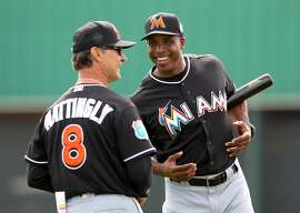 JUPITER, FL - FEBRUARY 23:  New manager Don Mattingly #8 and new hitting coach Barry Bonds #25 of the Miami Marlins during a team workout on February 23, 2016 in Jupiter, Florida. (Photo by Rob Foldy/Getty Images)