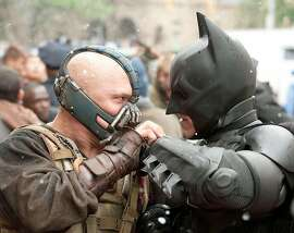 Tom Hardy as Bane and Christian Bale as Batman in �The Dark Knight Rises.� MUST CREDIT: Ron Phillips, Warner Bros. Entertainment Inc. and Legendary Pictures Funding LLC