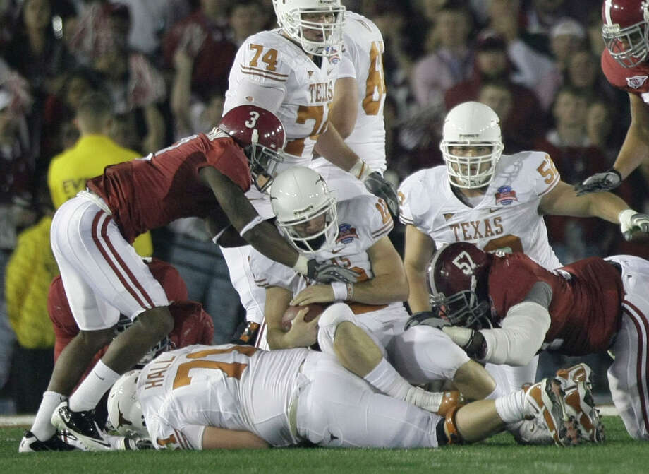 Texas quarterback Colt McCoy (12) finds no room to run during the first quarter of the Citi BCS National Championship football game at the Rose Bowl on Thursday, Jan. 7, 2010, in Pasadena, Calif. He left the game following the play. ( Brett Coomer / Chronicle ) Photo: Brett Coomer, Houston Chronicle / © 2010 Houston Chronicle