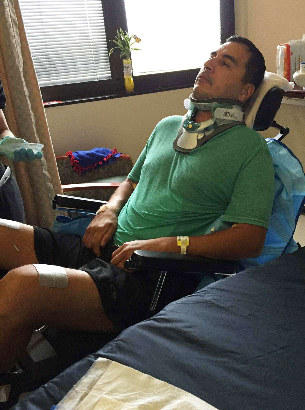 Roger Carlos is getting physical therapy in Houston for paralysis resulting from complications of surgery to relieve pain he suffered during the mistaken beating by San Antonio Police Department officers.
