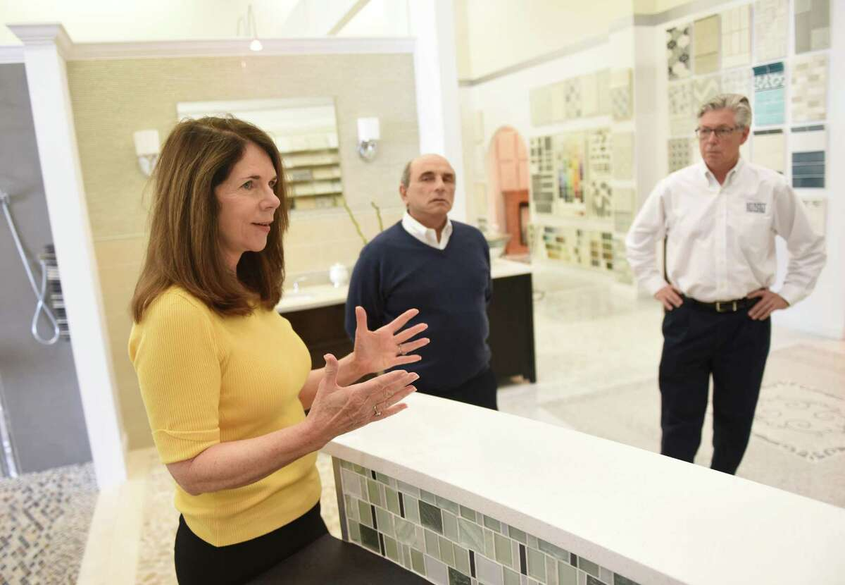 Fordham Marble Sales Manager Joyce Sardo, left, Fordham Marble Owner Mario Sardo and Murphy Brothers Contracting New Project Development Michael Murphy talk about the new website Houzz at Fordham Marble in Stamford on Wednesday.