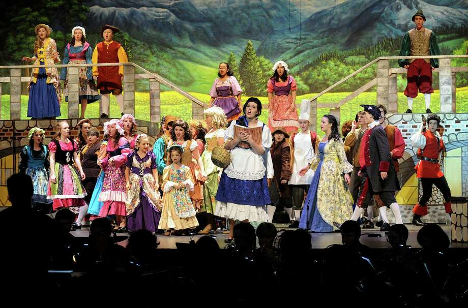 "Catie Ingersoll, center, plays Belle, in ""Beauty and the Beas,"" staged by the Newtown High School Drama department. The musical play runs from Wednesday through Sunday this week, 7PM daily except Sunday. Saturday there is  a second performance at 2PM and Sunday 2pm only. Tickets are $18. $14 for students and seniors and are available at the door or go to nhsc.booktix.com to pre-purchase. Photo: Carol Kaliff / Hearst Connecticut Media / The News-Times"