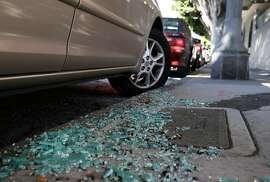 Shattered glass from a recent car break-in remains on the sidewalk on Bay Street near Kearny Street in San Francisco, Calif. on Wednesday, Sept. 9, 2015. Police officials say auto burglaries have doubled from last year, especially along Bay Street in Fisherman's Wharf, Union Square and the Embarcadero.