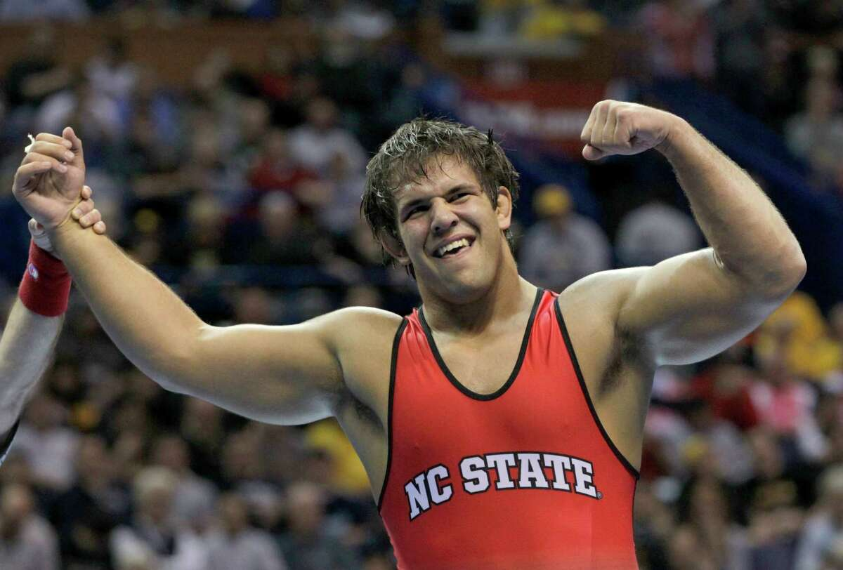 North Carolina State's Nick Gwiazdowski celebrates after defeating Michigan's Adam Coon 7-6 in their 285-pound championship match Saturday, March 21, 2015, at the NCAA Division I Wrestling Championships in St. Louis. (AP Photo/Tom Gannam) ORG XMIT: MOTG121