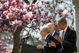 Federal appeals court judge Merrick Garland, left, accompanied by President Barack Obama and Vice President Joe Biden, steps to the microphone as he is introduced as Obama's nominee for the Supreme Court during an announcement in the Rose Garden of the White House, in Washington, Wednesday, March 16, 2016. (AP Photo/Andrew Harnik)