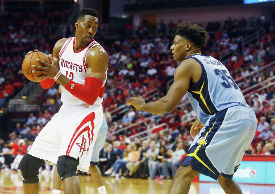 HOUSTON, TX - MARCH 14:  Dwight Howard #12 of the Houston Rockets looks to drive with the basketball against Alex Stepheson #35 of the Memphis Grizzlies during their game at the Toyota Center on March 14, 2016 in Houston, Texas.  (Photo by Scott Halleran/Getty Images) Photo: Scott Halleran, Staff / 2016 Getty Images