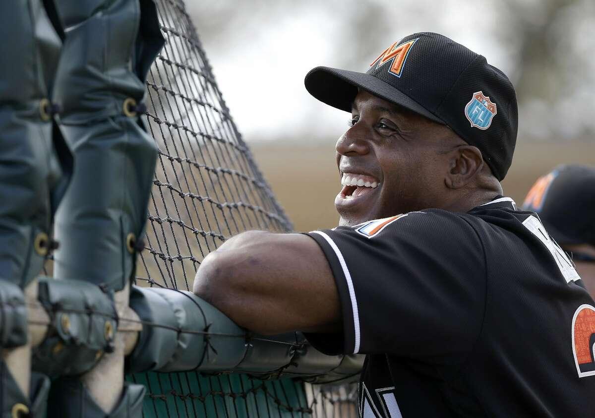 Miami Marlins hitting coach Barry Bonds smiles as he watches spring training baseball batting practice Monday, Feb. 22, 2016, in Jupiter, Fla. (AP Photo/Jeff Roberson)