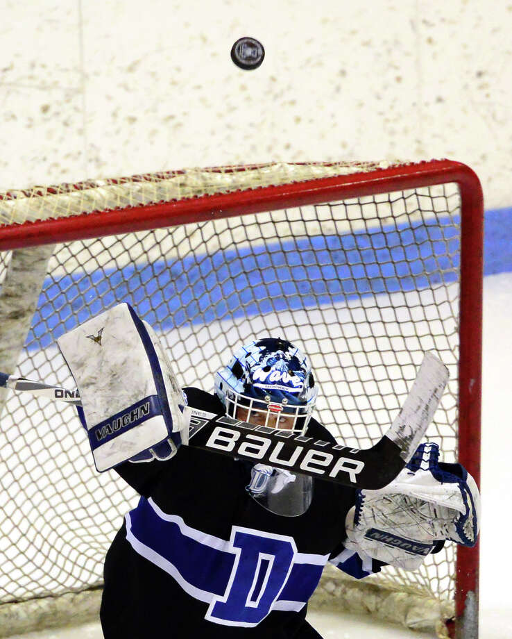 Darien goalie David Voigt deflects a shot by Notre Dame of West Haven during Division I boys hockey semi-finals action in New Haven, Conn., on Wednesday March 16, 2016. Photo: Christian Abraham / Hearst Connecticut Media / Connecticut Post