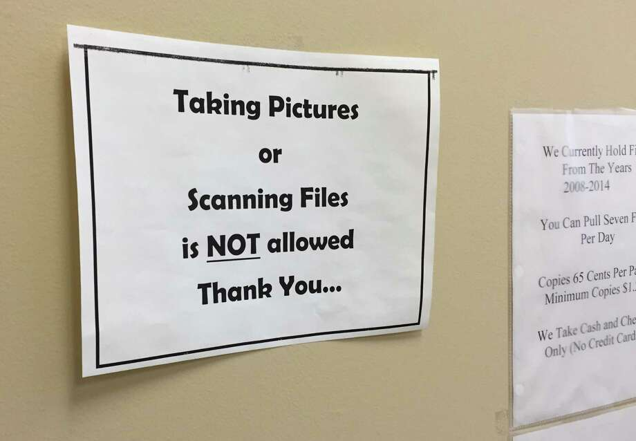 Sign posted in the clerk's record room at the Albany County Courthouse on Tuesday, March 15, 2016, in Albany, N.Y. A policy in the County Clerk's office, the repository for many criminal and civil court records, prohibits the public from snapping photos of public court filings with their phones. (Jordan Carleo-Evangelist/Times Union)