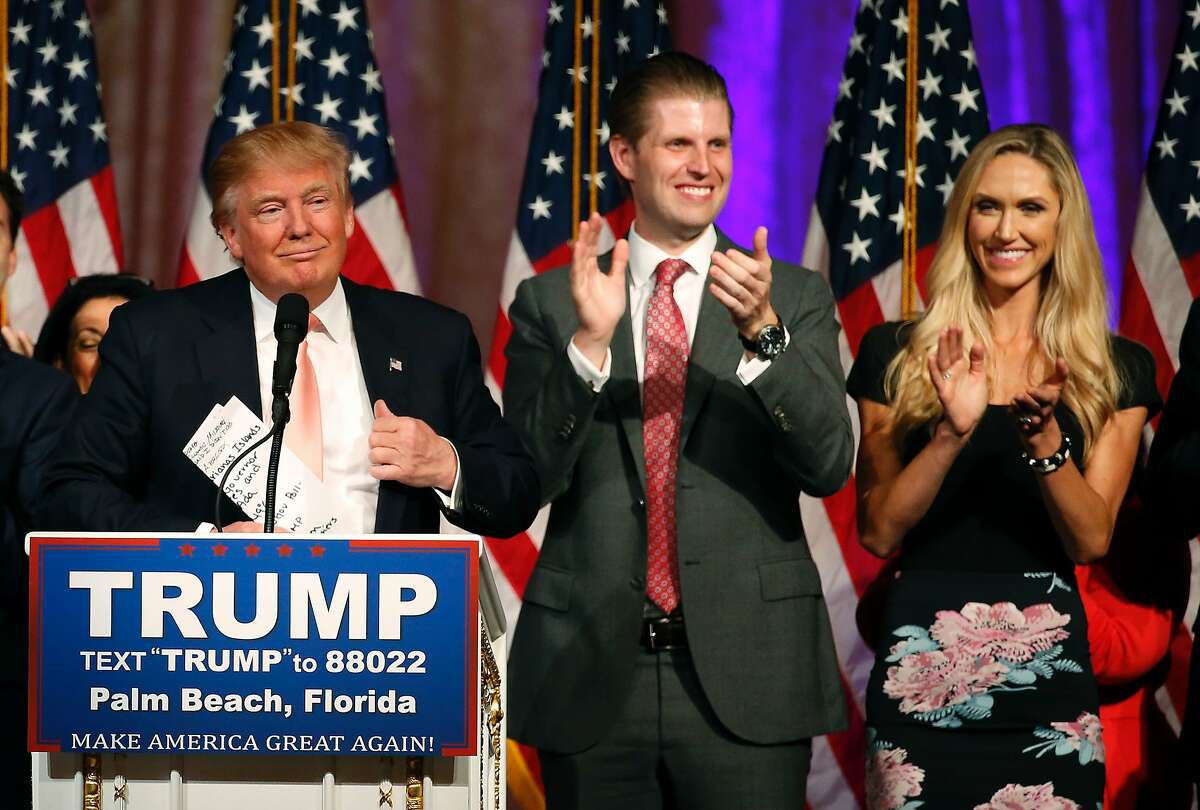 CORRECTION - Republican presidential candidate Donald Trump (L), with his son Eric Trump (C) and daughter-in-law, Lara Trump (R), addresses the media following victory in the Florida state primary on March 15, 2016 in West Palm Beach, Florida. / AFP PHOTO / RHONA WISE / The erroneous mentions appearing in the metadata of these photos by RHONA WISE has been modified in AFP systems in the following manner: [Republican presidential candidate Donald Trump (L), with his son Eric Trump (C) and daughter-in-law, Lara Trump (R),] instead of [Republican presidential candidate Donald Trump (L) with his son Donald Trump Jr (C) and daughter - in - law Vanessa Trump (R)]. Please immediately remove the erroneous mentions from all your online services and delete them from your servers. If you have been authorized by AFP to distribute them to third parties, please ensure that the same actions are carried out by them. Failure to promptly comply with these instructions will entail liability on your part for any continued or post notification usage. Therefore we thank you very much for all your attention and prompt action. We are sorry for the inconvenience this notification may cause and remain at your disposal for any further information you may require.RHONA WISE/AFP/Getty Images