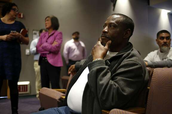 Johnnie Pullen, a homeless man who will benefit from the new housing compact, listens to a speak during a signing ceremony at San Leandro City Hall on Wednesday, March 16, 2016.