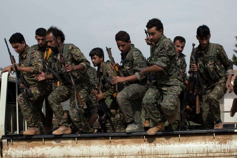 Syrian Kurdish parties, like these militia fighters, are working on a plan to declare a federal region across much of northern Syria, several of their representatives said Thursday. The Syrian and Turkish governments are opposing the move. Photo: TYLER HICKS, STF / NYTNS