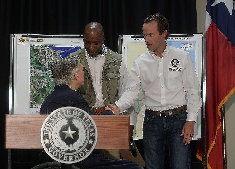 Texas Governor Greg Abbott greets Texas State Representatives James White (left) and Dade Phelan before a press conference at the Emergency Management Center in Orange Wednesday. Abbott toured the destruction in the region before gathering at the center to meet with local officials, after which he addressed the media about the crisis and steps that will be taken to assist those affected. Photo taken Wednesday, March 16, 2016 Kim Brent/The Enterprise Photo: Kim Brent / Beaumont Enterprise