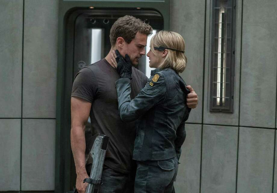 "This image released by Lionsgate shows Shailene Woodley, right, and Theo James in a scene from ""The Divergent Series: Allegiant."" (Murray Close/Lionsgate via AP) Photo: Murray Close, HONS / AP / Lionsgate"