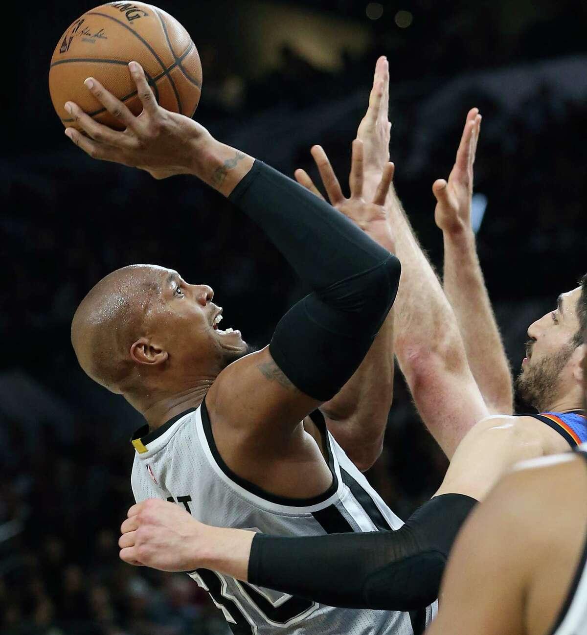 David West leans back to get a two pointer as the Spurs host the Thunder at the AT&T Center on March 12, 2016.