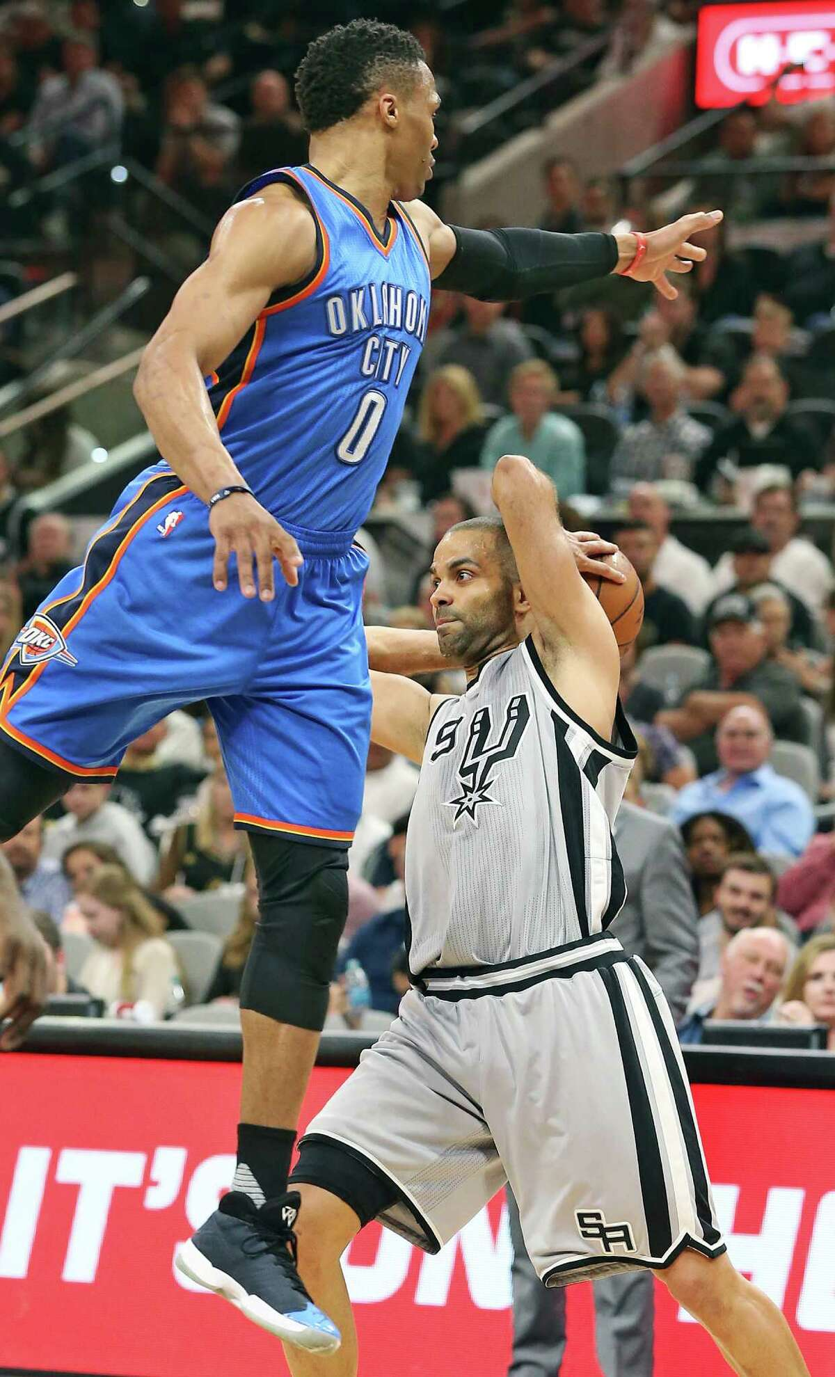 Tony Parker gets Russell Westbrokk airborne as the Spurs host the Thunder at the AT&T Center on March 12, 2016.