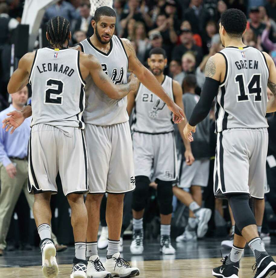 LaMarcus Aldridge takes congratulations from Kawhi Leonard as the two high point leaders finish the game as the Spurs host the Thunder at the AT&T Center  on March 12, 2016. Photo: TOM REEL, STAFF / SAN ANTONIO EXPRESS-NEWS / 2016 SAN ANTONIO EXPRESS-NEWS