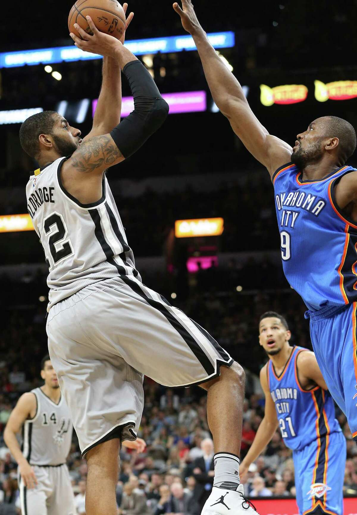LaMarcus Aldridge shoots over Serge Ibaka as the Spurs host the Thunder at the AT&T Center on March 12, 2016.