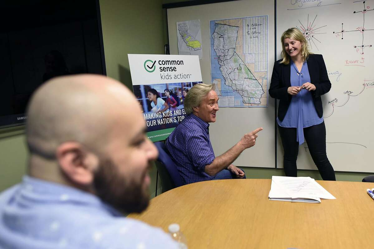 California campaign director Buffy Wicks, right, looks on as CEO Jim Steyer speaks during a meeting at Common Sense Media's offices in San Francisco, CA Wednesday, March 16, 2016.