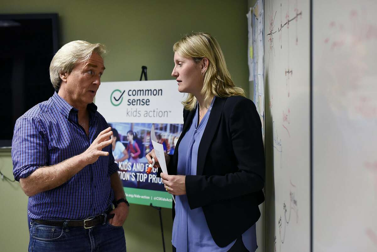 California campaign director Buffy Wicks, right, speaks with CEO Jim Steyer following a meeting at Common Sense Media's offices in San Francisco, CA Wednesday, March 16, 2016.