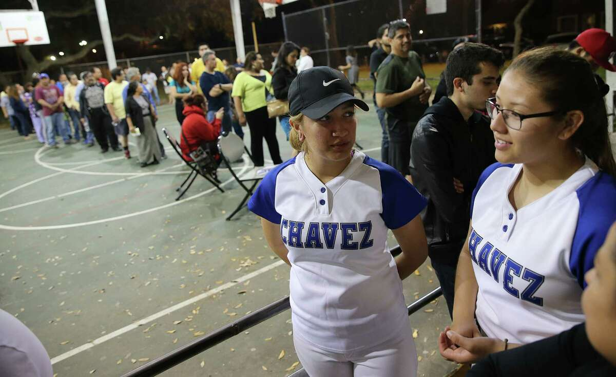 Jasmine Ward, 18, left, and Stephanie Martinez, 19, seniors at Chavez High School, were among the hundreds who had to wait in line to vote at DeZavala Park Community Center on Super Tuesday on March 1.
