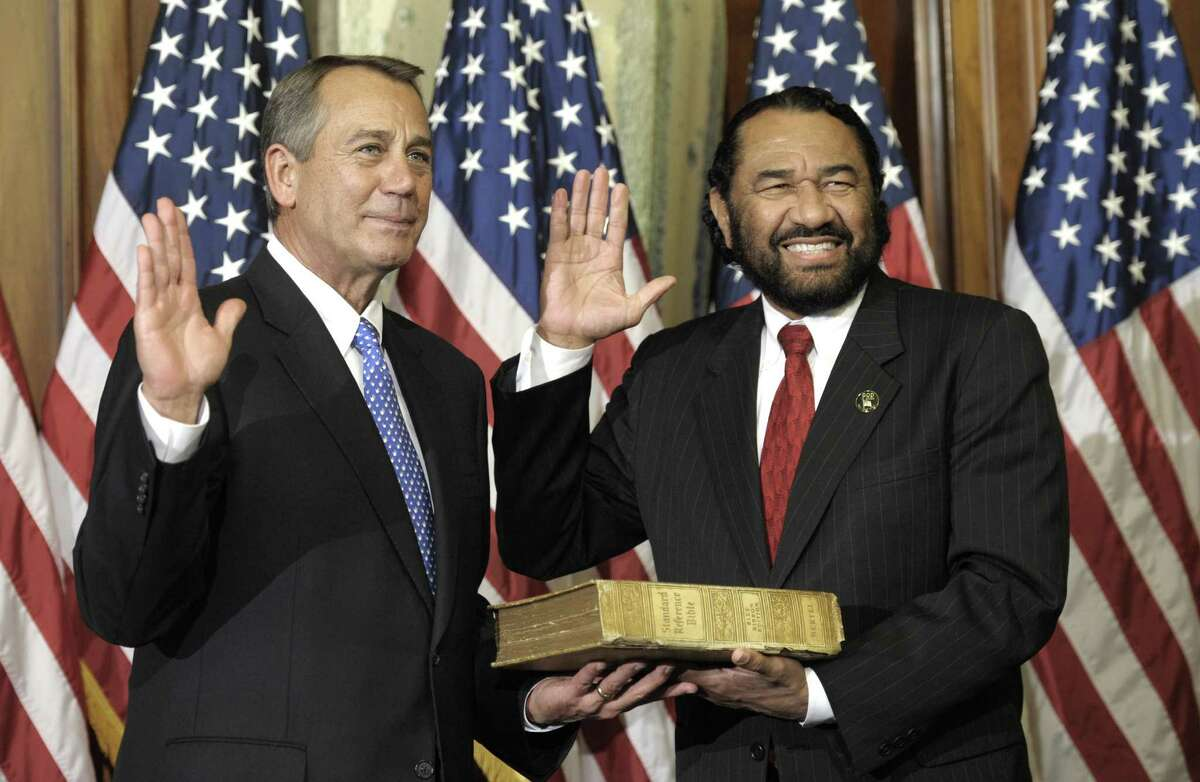 House Speaker John Boehner of Ohio, left, performs a mock swearing in for Rep. Al Green, D-Texas, Thursday, Jan. 3, 2013, on Capitol Hill in Washington as the 113th Congress began. (AP Photo/Cliff Owen)