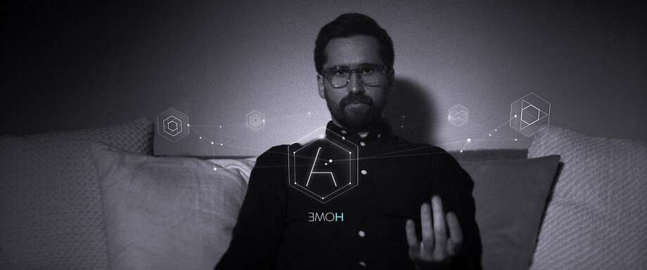 Benjamin Dickinson gets lost in the possibilities of Augmenta, an augmented reality system in a pair of glasses. Photo: AP