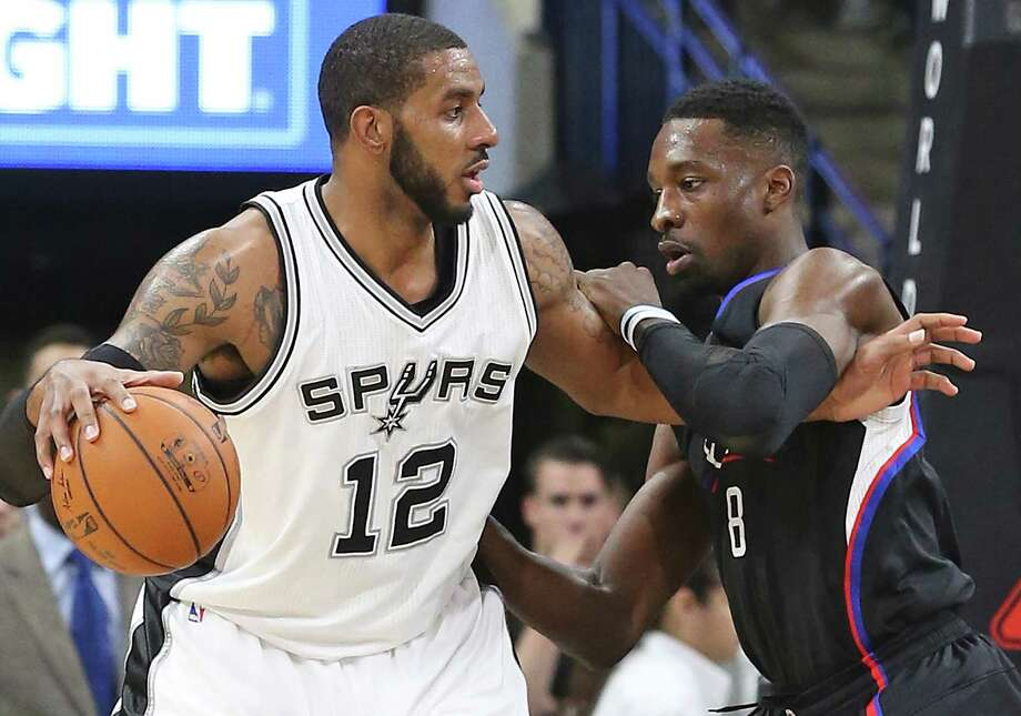 LaMarcus Aldridge posts up on Jeff Green as the Spurs host the Clippers at the AT&T Center  on March 15, 2016. Photo: TOM REEL, STAFF / SAN ANTONIO EXPRESS-NEWS / 2016 SAN ANTONIO EXPRESS-NEWS
