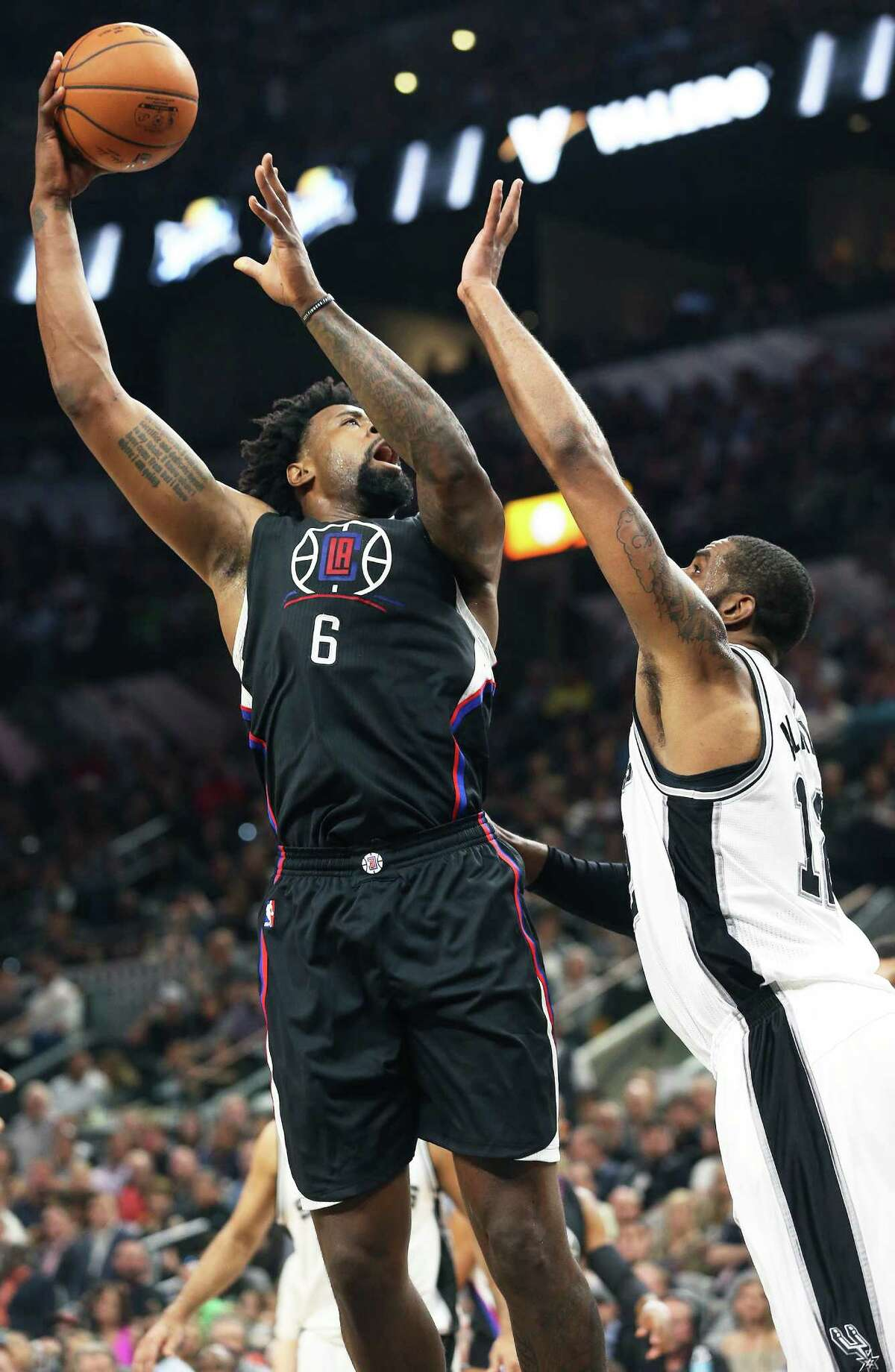 DeAndre Jordan takes a shot over LaMarcus Aldridge as the Spurs host the Clippers at the AT&T Center on March 15, 2016.