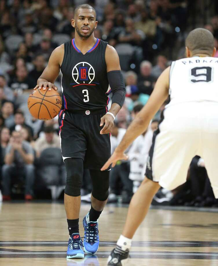 Chris Paul looks over Tony Parker as he approaches with the ball as the Spurs host the Clippers at the AT&T Center  on March 15, 2016. Photo: TOM REEL, STAFF / SAN ANTONIO EXPRESS-NEWS / 2016 SAN ANTONIO EXPRESS-NEWS