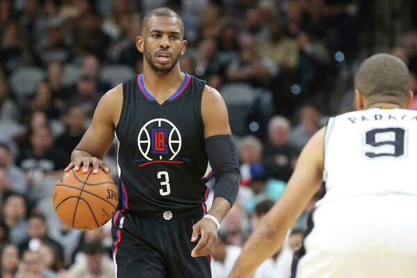 Chris Paul looks over Tony Parker as he approaches with the ball as the Spurs host the Clippers at the AT&T Center  on March 15, 2016.