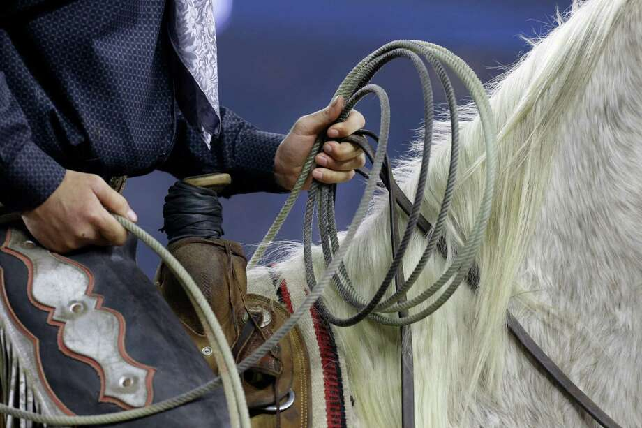 A cowboy holds a lasso during the RodeoHouston during the Houston Livestock Show and Rodeo in NRG Stadium Wednesday, March 16, 2016, in Houston. Photo: Melissa Phillip, Houston Chronicle / © 2016 Houston Chronicle