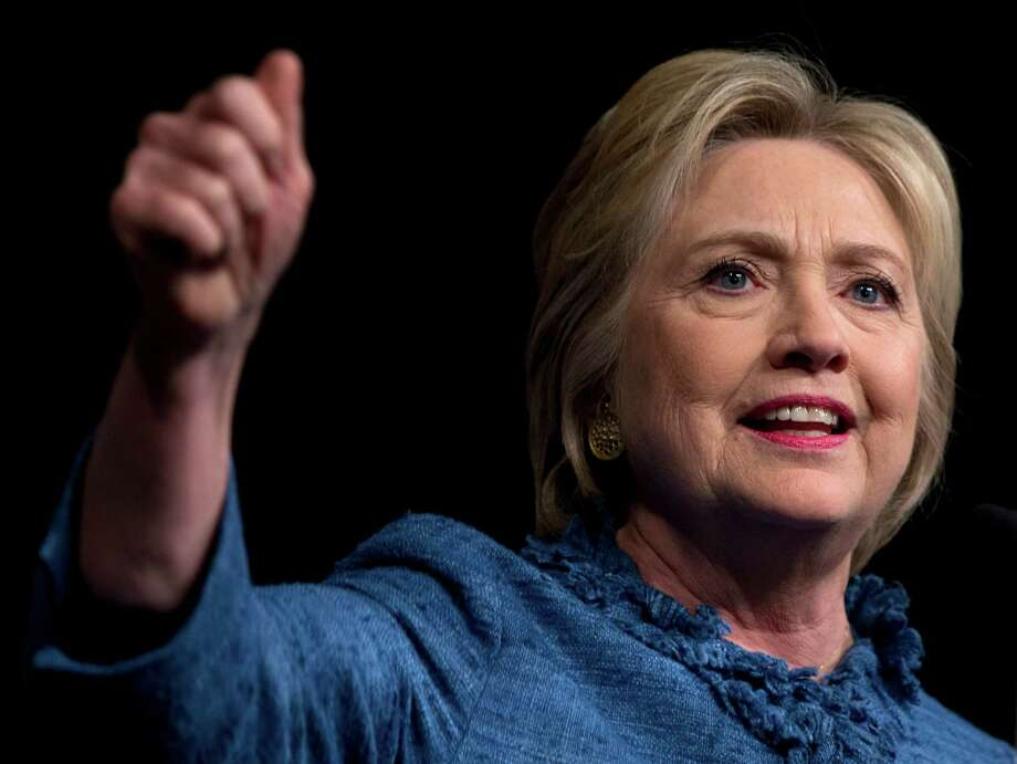 Democratic presidential candidate Hillary Clinton speaks during an election night event at the Palm Beach County Convention Center in West Palm Beach, Fla., Tuesday. (AP Photo/Carolyn Kaster) ORG XMIT: FLCK143 Photo: Carolyn Kaster / AP