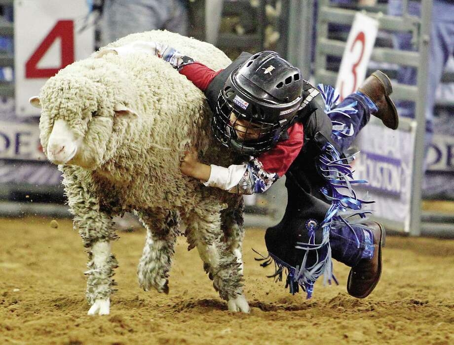 Six-year-old Martin Rincon competes during Mutton Bustin' the event at the Houston Livestock Show and Rodeo in Reliant Stadium Sunday, March 11, 2012, in Houston.  ( James Nielsen / Chronicle ) Six-year-old Martin Rincon competes during Mutton Bustin' the event at the Houston Livestock Show and Rodeo in Reliant Stadium Sunday, March 11, 2012, in Houston.  ( James Nielsen / Chronicle ) Photo: James Nielsen, Staff / © 2012 Houston Chronicle
