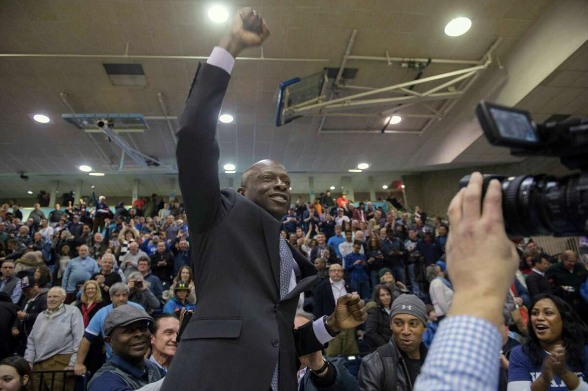 Yale men's basketball coach James Jones celebrates the win at the end of the second half of an NCAA Ivy League Conference basketball college game Saturday, March 5, 2016, in New York. Yale beat Columbia 71-55. (AP Photo/Bryan R. Smith) ORG XMIT: NYBS108