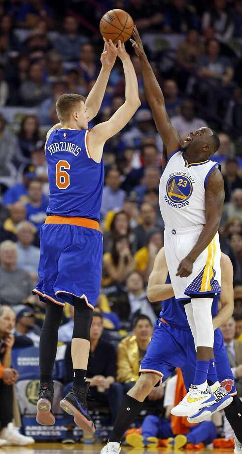 Golden State Warriors' Draymond Green blocks a shot attempt by New York Knicks' Kristaps Porzingis in 1st quarter of NBA game at Oracle Arena in Oakland, Calif., on Wednesday, March 16, 2016. Photo: Scott Strazzante, The Chronicle