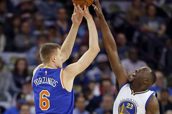 Golden State Warriors' Draymond Green blocks a shot attempt by New York Knicks' Kristaps Porzingis in 1st quarter of NBA game at Oracle Arena in Oakland, Calif., on Wednesday, March 16, 2016.