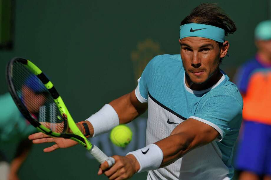 Rafael Nadal, of Spain, returns to Alexander Zverev, of Germany, during the BNP Paribas Open tennis tournament, Wednesday, March 16, 2016, in Indian Wells, Calif. (AP Photo/Mark J. Terrill) Photo: Mark J. Terrill, STF / AP