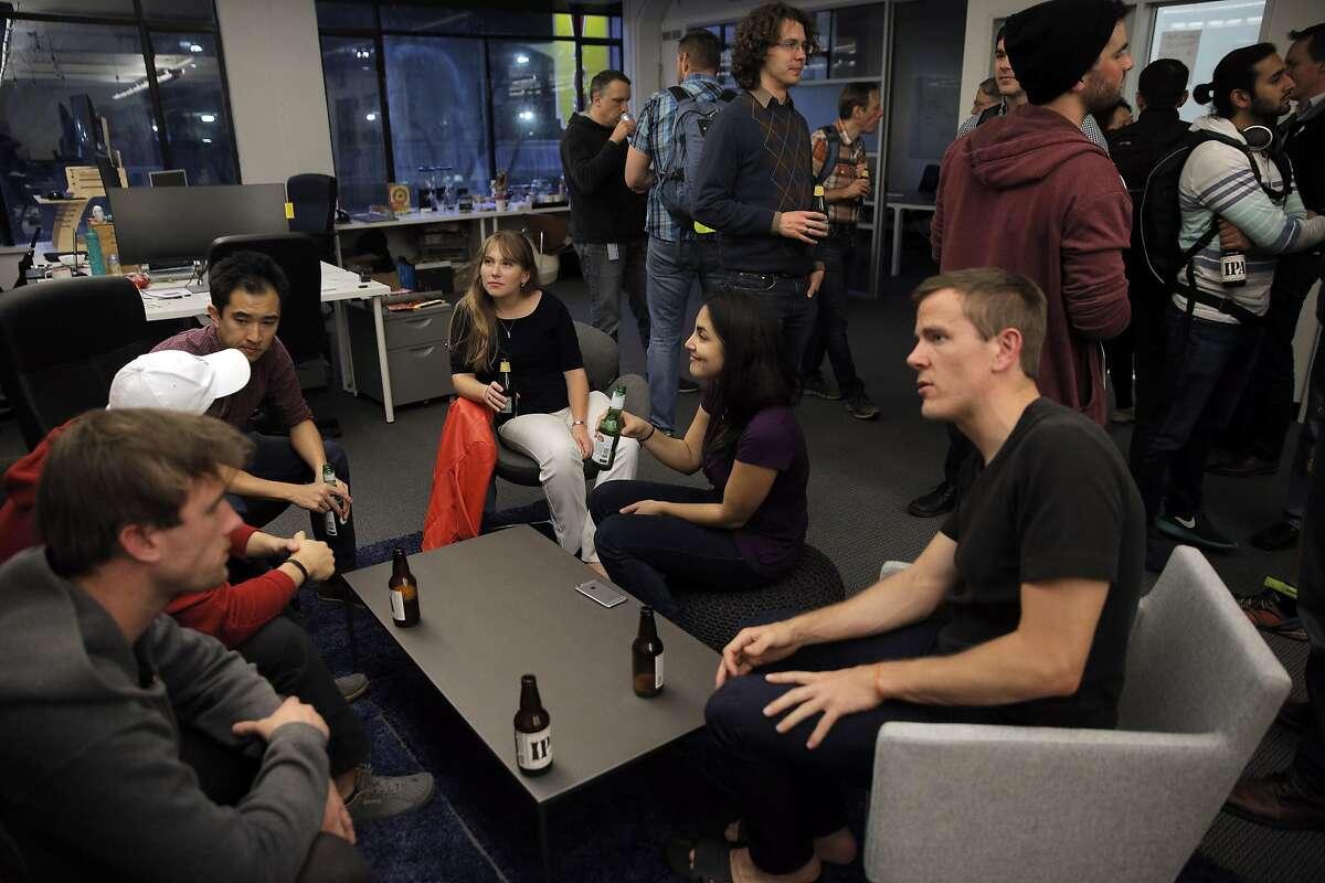 Robotics afficionados chat during a social meetup of San Francisco's community of robot aficionados, and their robots put on by Silicon Valley Robotics at Comet Labs in San Francisco, Calif., on Wednesday, March 16, 2016.