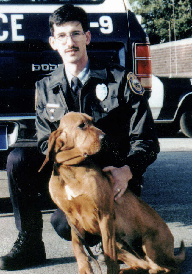 Officer Dale Call, then a K-9 handler for the police force, with his first bloodhound, Bisbee. Photo: Contributed Photo / Contributed Photo / Westport News