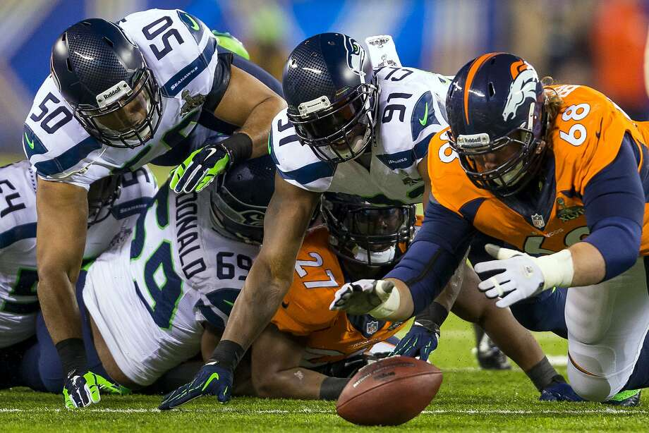 Zane Beadles, then with the Broncos, recovers a fumble in Super Bowl XLVIII. Photo: JORDAN STEAD, SEATTLEPI.COM