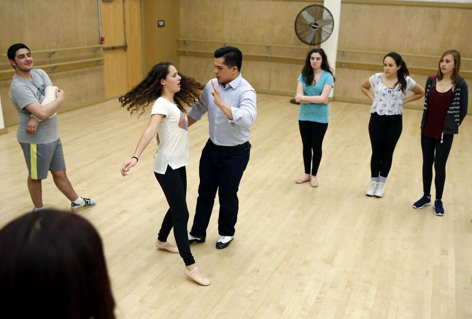 Vincent Rodriguez III bumps into Lilah Segal-Angel as he demonstrates character development to a youth theater company. Photo: Connor Radnovich, The Chronicle
