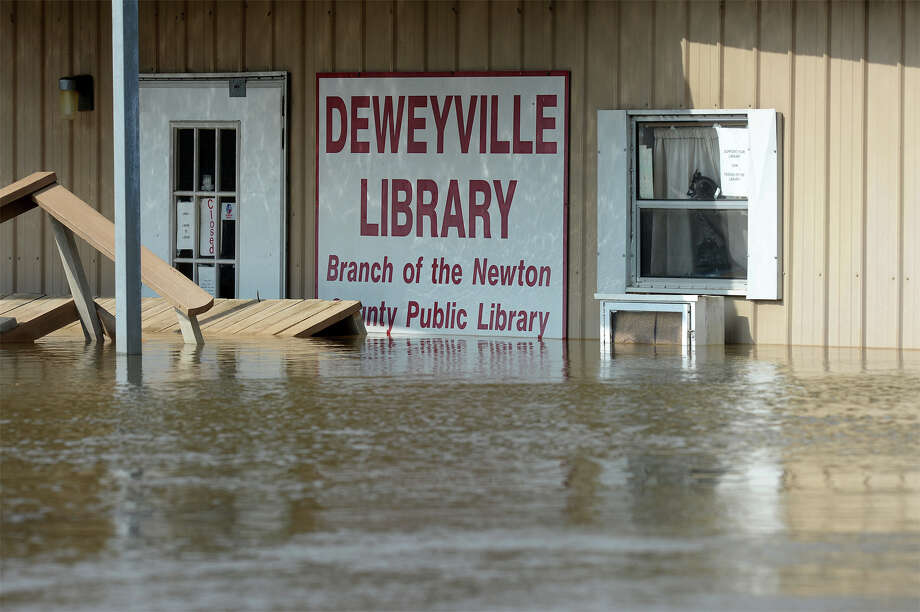 The Deweyville Library effected by flooding on Wednesday. While waters seem to have begun to subside, it is still unknown when residents will be able to return. A few residents are riding out the flood waters in their home, but have been told by authorities that if they leave they cannot return. Photo taken Wednesday, March 16, 2016. Guiseppe Barranco/The Enterprise Photo: Guiseppe Barranco, Photo Editor