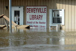 The Deweyville Library effected by flooding on Wednesday. While waters seem to have begun to subside, it is still unknown when residents will be able to return. A few residents are riding out the flood waters in their home, but have been told by authorities that if they leave they cannot return. Photo taken Wednesday, March 16, 2016. Guiseppe Barranco/The Enterprise