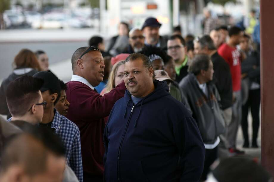 Customers line up to board free shuttle busses at the Pittsburg/Bay Point BART station in Pittsburg, CA Thursday, March 17, 2016.   Free shuttle bus service was offered as BART service was out between the Pittsburg/Bay Point and Concord stations due to an electrical problem. Photo: Michael Short, Special To The Chronicle